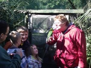Tim, Hamish, Duncan, Louise and Kaz, with parakeet